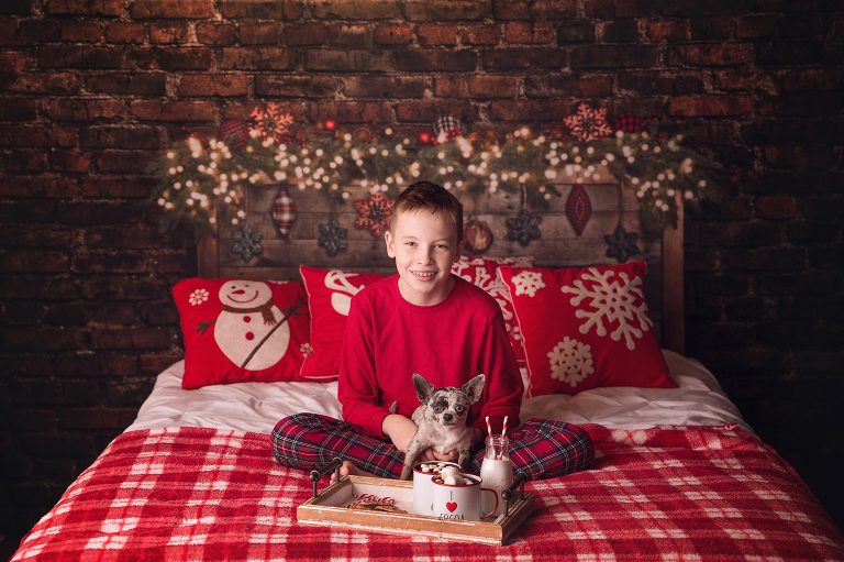 Holiday photo sessions on a christmas bed setup