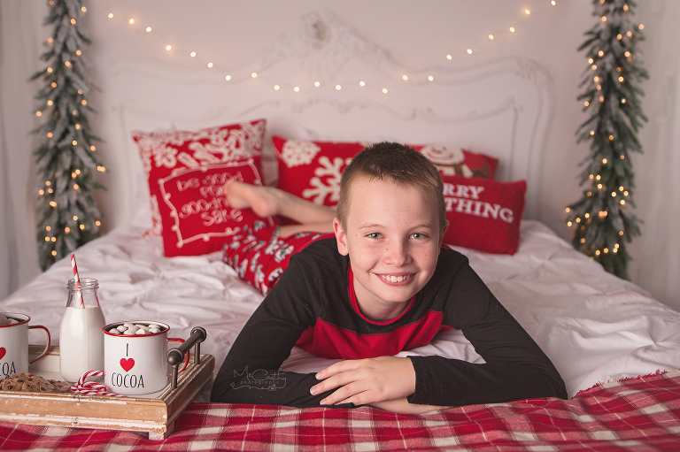 photos on a holiday bed with trees and lights