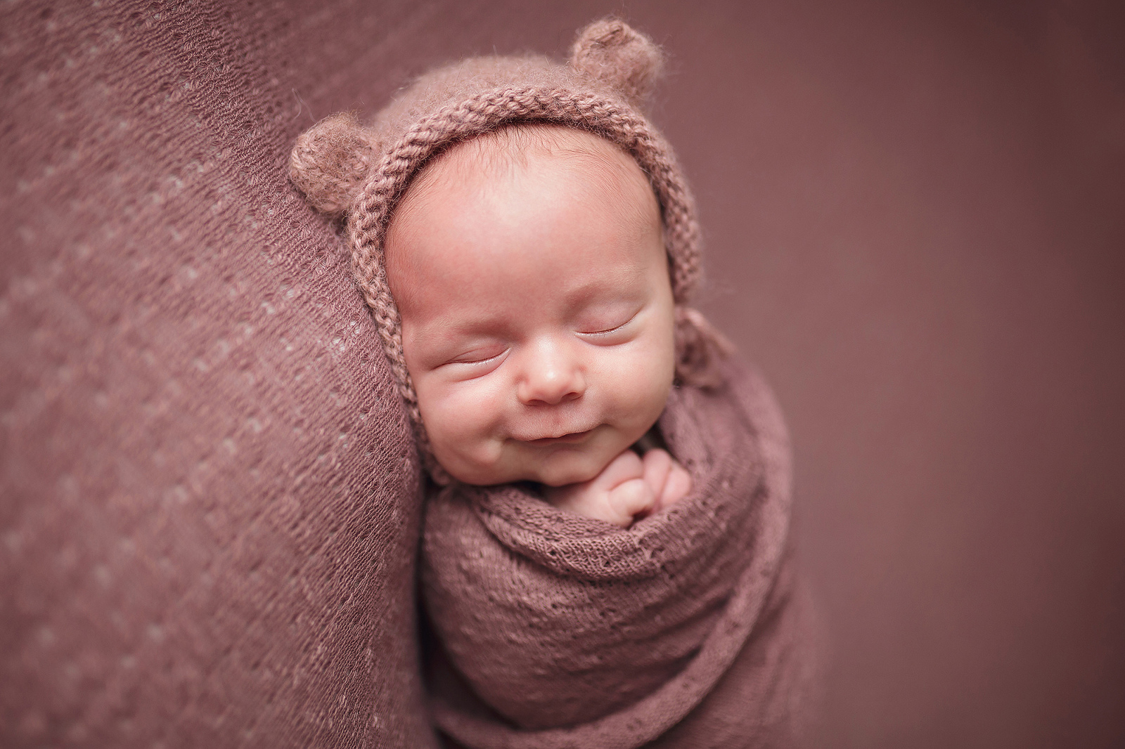 knit baby bear hat on a newborn